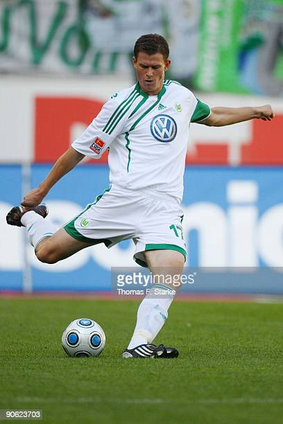 Alexander Madlung of Wolfsburg runs with the ball during the Bundesliga match between VfL Wolfsburg and Bayer Leverkusen at Volkswagen Arena on...