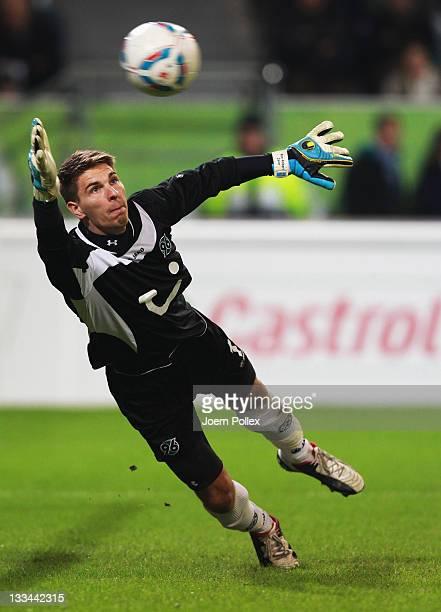 Alexander Madlung of Wolfsburg scores his team's fourth goal past goalkeeper Ron-Robert Zieler of Hannover during the Bundesliga match between VfL...