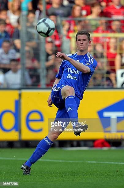 Alexander Madlung of Wolfsburg with the ball during the Bundesliga match between SC Freiburg and VfL Wolfsburg at Badenova Stadium April 25, 2010 in...