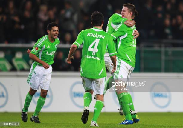 Alexander Madlungn of Wolfsburg celebrates with his team mates after scoring his team's fourth goal during the Bundesliga match between VfL Wolfsburg...