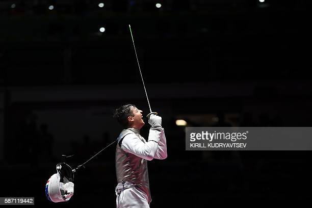 Alexander Massialas celebrates winning against Great Britain's Richard Kruse in their mens individual foil semi-final bout as part of the fencing...