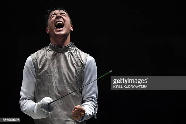 Alexander Massialas celebrates winning against Italy's Giorgio Avola in their mens individual foil quarter-final bout as part of the fencing event of...