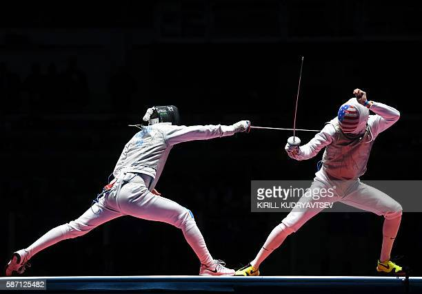 Alexander Massialas competes against Italy's Daniele Garozzo during the mens individual foil gold medal bout as part of the fencing event of the Rio...