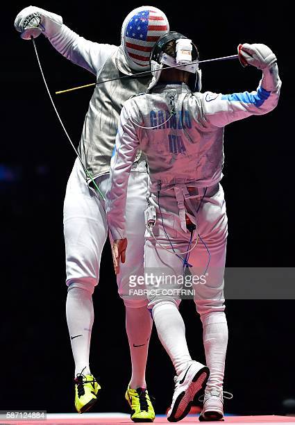 Alexander Massialas Italy's Daniele Garozzo during the mens individual foil gold medal bout as part of the fencing event of the Rio 2016 Olympic...