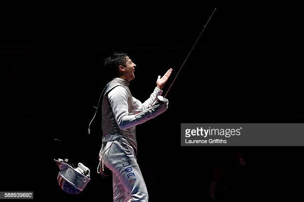 Alexander Massialas of the United States celebrates after defeating Andrea Baldini of Italy to help the United States defeat Italy in the Men's Foil...