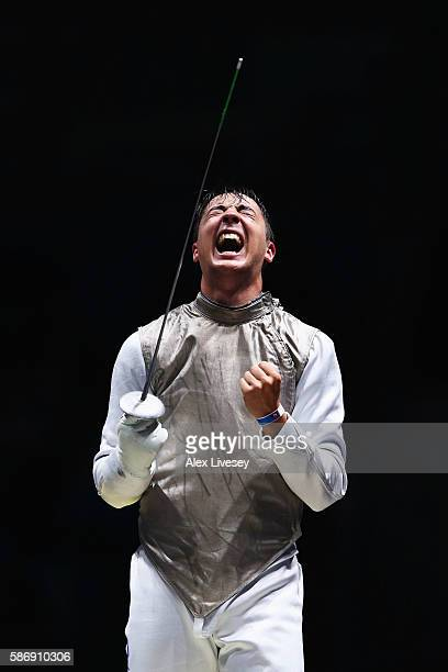 Alexander Massialas of the United States celebrates defeating Giorgio Avola of Italy during Men's Individual Foil on Day 2 of the Rio 2016 Olympic...
