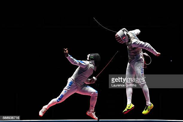 Alexander Massialas of the United States competes against Andrea Baldini of Italy during the Men's Foil Team Bronze Medal Match bout on Day 7 of the...