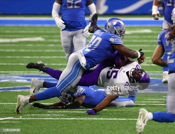 Alexander Mattison of the Minnesota Vikings is tackled by Jarrad Davis of the Detroit Lions in the first quarter at Ford Field on January 3, 2021 in...