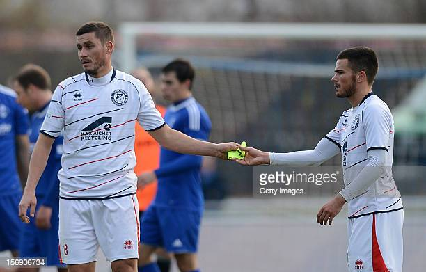 Alexander Maul of Seligenporten passes his captain's armband to teammate Marco Wiedmann of Seligenporten after receiving a red card during the...