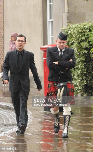Alexander McQueen and an unidentified man arrive at Gloucester Cathedral for Isabella Blow's funeral service