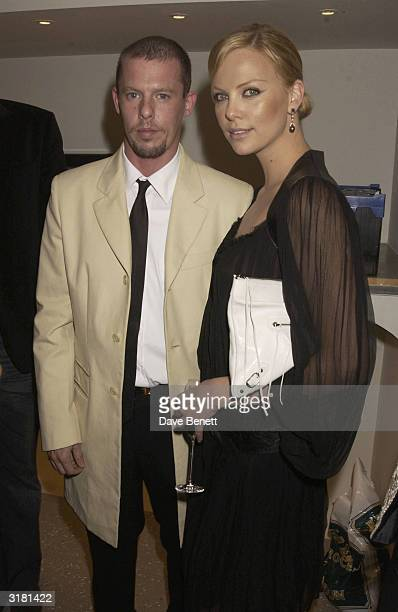Alexander McQueen and Charlize Theron attend the Launch Party For Alexander McQueen's New Store at Old Bond Street on May 7 2003 in London