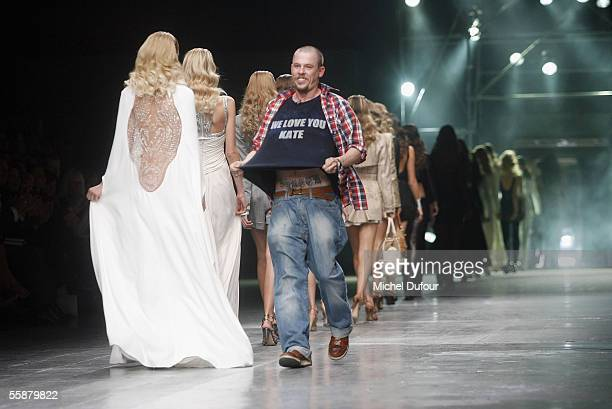 Alexander McQueen and Models walk down the catwalk during the Alexander McQueen show as part of Paris Fashion Week Spring/Summer 2006 on October 7...
