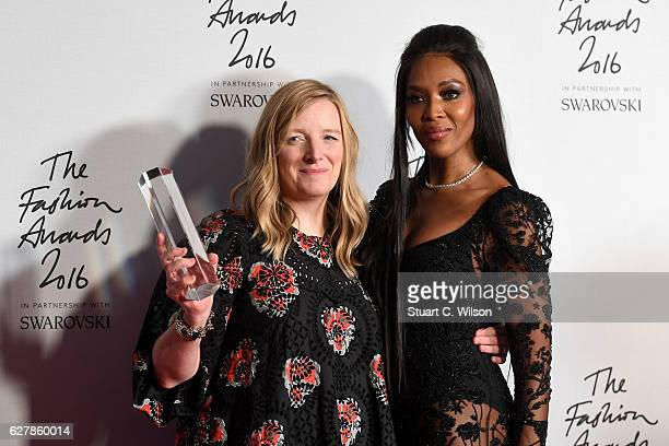 Alexander McQueen designer Sarah Burton poses in the winners room with model Naomi Campbell after winning the British Brand Award at The Fashion...
