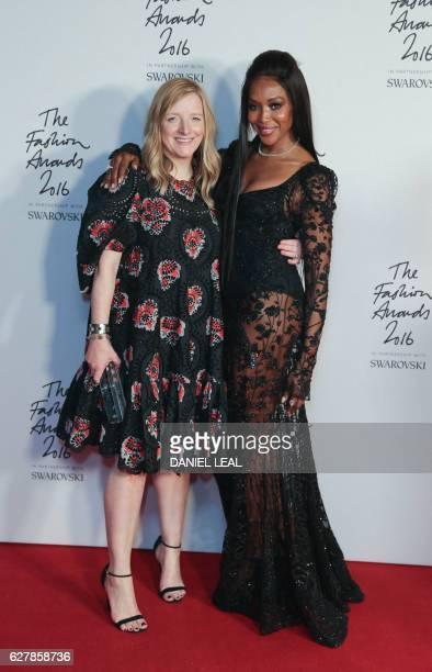 Alexander McQueen fashion designer Sarah Burton poses with her award alonside the award's presenter British model Naomi Campbell after Alexander...