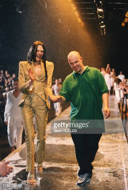 Alexander McQueen with a model at his London Spring/Summer Collection fashion show on September 28 in London United Kingdom