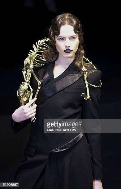 Alexander McQueen's model wears a goldpainted fox skeletonwrap on the fourth day of the London Fashion Week 21 February 2001