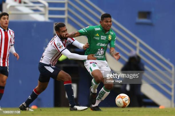 Alexander Media of Club Leon fights for the ball with Miguel Basulto of Chivas during a friendly match between Chivas and Club Leon at Cotton Bowl...