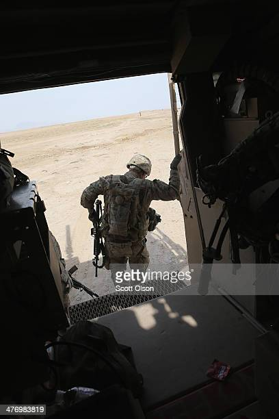 Alexander Medina from Keshena Wisconsin with the US Army's 4th squadron 2d Cavalry Regiment climbs from an MRAP for a patrol through a village on...