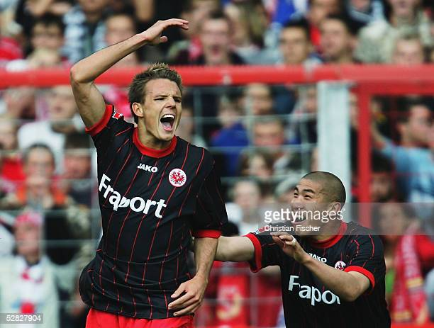 Alexander Meier and his teammate Du Ri Cha of Frankfurt celebrate a goal during the match of the Second Bundesliga between Energie Cottbus and...