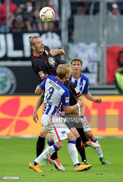 Alexander Meier of Eintracht Frankfurt and Per Skjelbred of Hertha BSC during the game between Eintracht Frankfurt and Hertha BSC on September 27...