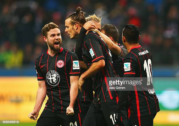 Alexander Meier of Eintracht Frankfurt celebrates with Marc Stendera and team mates as he scores their first and equalising during the Bundesliga...