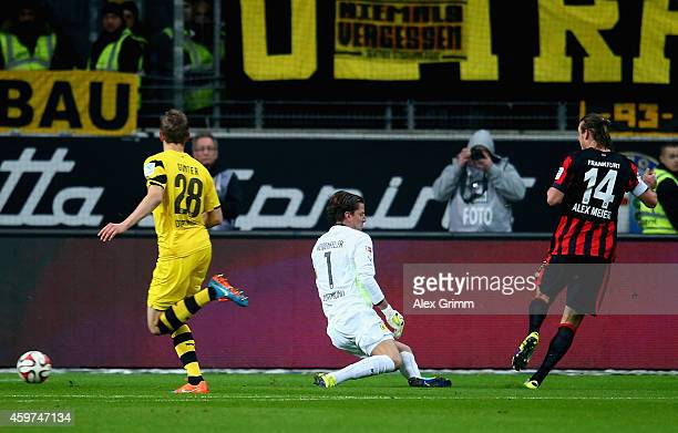 Alexander Meier of Eintracht Frankfurt scores his team's first goal past Roman Weidenfeller of Borussia Dortmund during the Bundesliga match between...