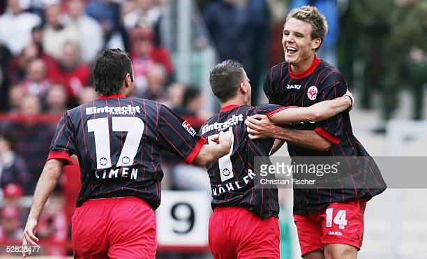 Alexander Meier of Frankfurt and his teammates Benjamin Koehler and Daniel Cimen celebrate a goal during the match of the Second Bundesliga between...