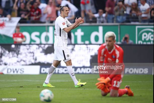 Alexander Meier of Frankfurt applauds and celebrates after he scored a goal to make it 30 during the Bundesliga match between Eintracht Frankfurt and...
