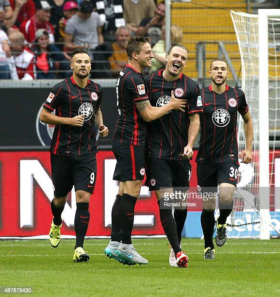 Alexander Meier of Frankfurt celebrates after scoring his team's first goal with his teammates Bastian Oczipka during the Bundesliga match between...