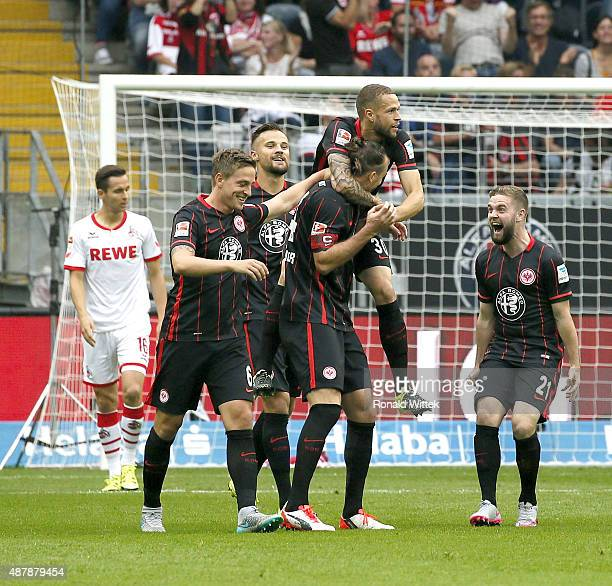 Alexander Meier of Frankfurt celebrates after scoring his team's first goal with his teammates Luc Castaignos during the Bundesliga match between...