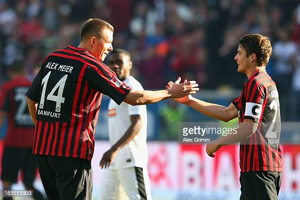 Alexander Meier of Frankfurt celebrates his team's first goal with team mate Pirmin Schwegler during the Bundesliga match between Eintracht Frankfurt...