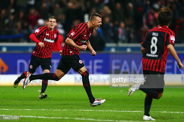 Alexander Meier of Frankfurt celebrates his team's first goal with team mates Sebastian Jung and Takashi Inui during the Bundesliga match between...