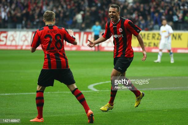 Alexander Meier of Frankfurt celebrates his team's third goal with team mate Sonny Kittel during the Second Bundesliga match between Eintracht...