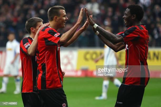 Alexander Meier of Frankfurt celebrates his team's third goal with team mate Mohamadou Idrissou and Sebastian Jung during the Second Bundesliga match...