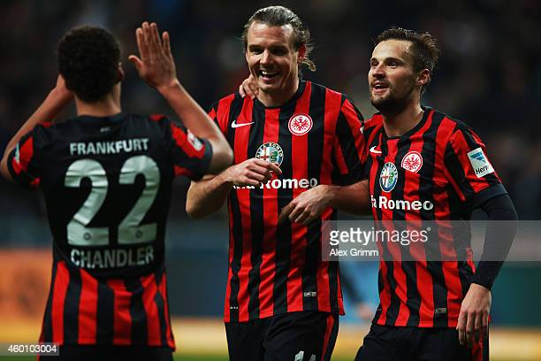 Alexander Meier of Frankfurt celebrates his team's third goal with team mate Haris Seferovic and Timothy Chandler during the Bundesliga match between...