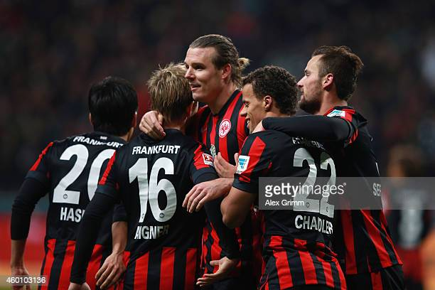 Alexander Meier of Frankfurt celebrates his team's third goal with team mates during the Bundesliga match between Eintracht Frankfurt and SV Werder...