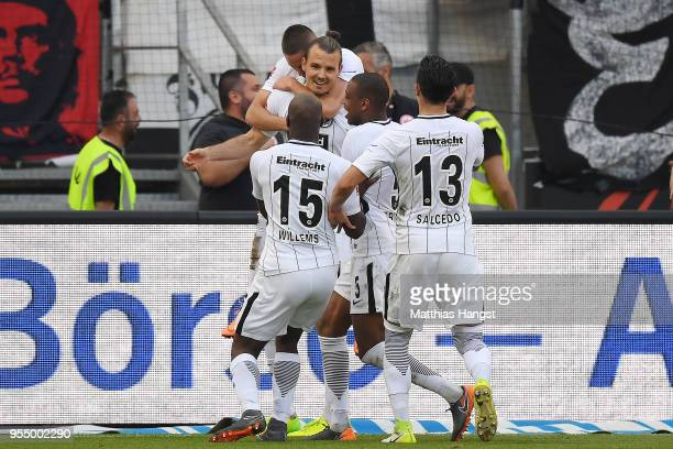 Alexander Meier of Frankfurt celebrates with his team after he scored a goal to make it 30 during the Bundesliga match between Eintracht Frankfurt...