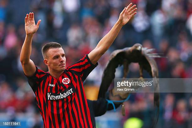 Alexander Meier of Frankfurt celebrates with supporters and mascot Attila after the Bundesliga match between Eintracht Frankfurt and SC Freiburg at...