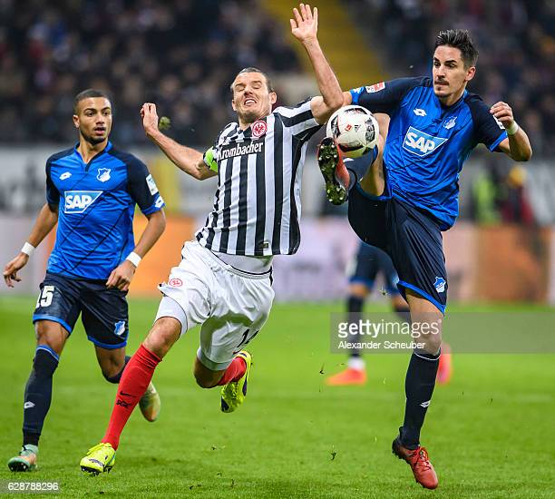 Alexander Meier of Frankfurt challenges Benjamin Huebner of Hoffenheim during the Bundesliga match between Eintracht Frankfurt and TSG 1899...