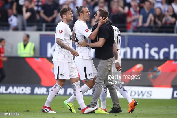Alexander Meier of Frankfurt is celebrates by a fan and his team after he scored a goal to make it 30 during the Bundesliga match between Eintracht...