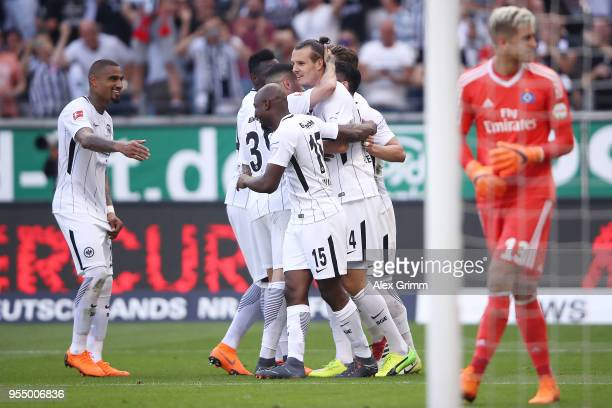 Alexander Meier of Frankfurt is celebrates by his team after he scored a goal to make it 30 during the Bundesliga match between Eintracht Frankfurt...