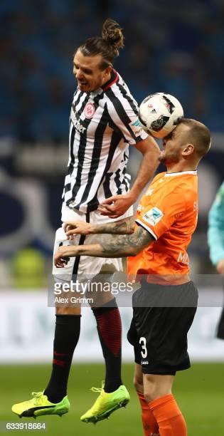Alexander Meier of Frankfurt is challenged by Alexander Milosevic of Darmstadt during the Bundesliga match between Eintracht Frankfurt and SV...