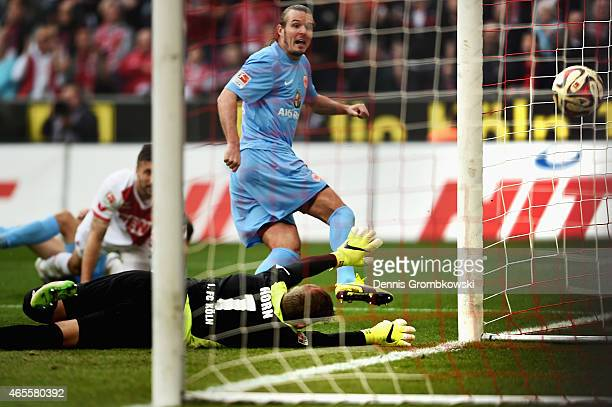 Alexander Meier of Frankfurt scores his team's first goal against goalkeeper Timo Horn of Koeln during the Bundesliga match between 1 FC Koeln and...