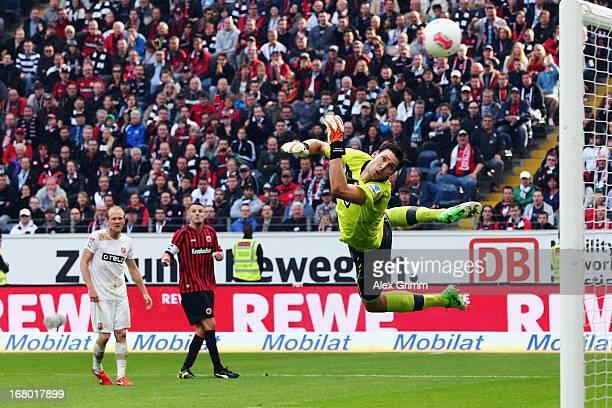 Alexander Meier of Frankfurt scores his team's third goal against goalkeeper Fabian Giefer of Duesseldorf during the Bundesliga match between...