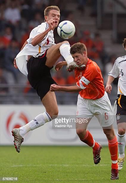 Alexander Meier of Germany kicks Stijn Schaars of Netherlands during the Men's Under 21 international friendly match between Netherlands and Germany...