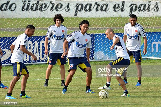 Alexander Mejia Esteffan Medina Abel Aguilar Carlos Valdes and Elkin Soto of Colombia warm up during a training session of Colombia on September 02...