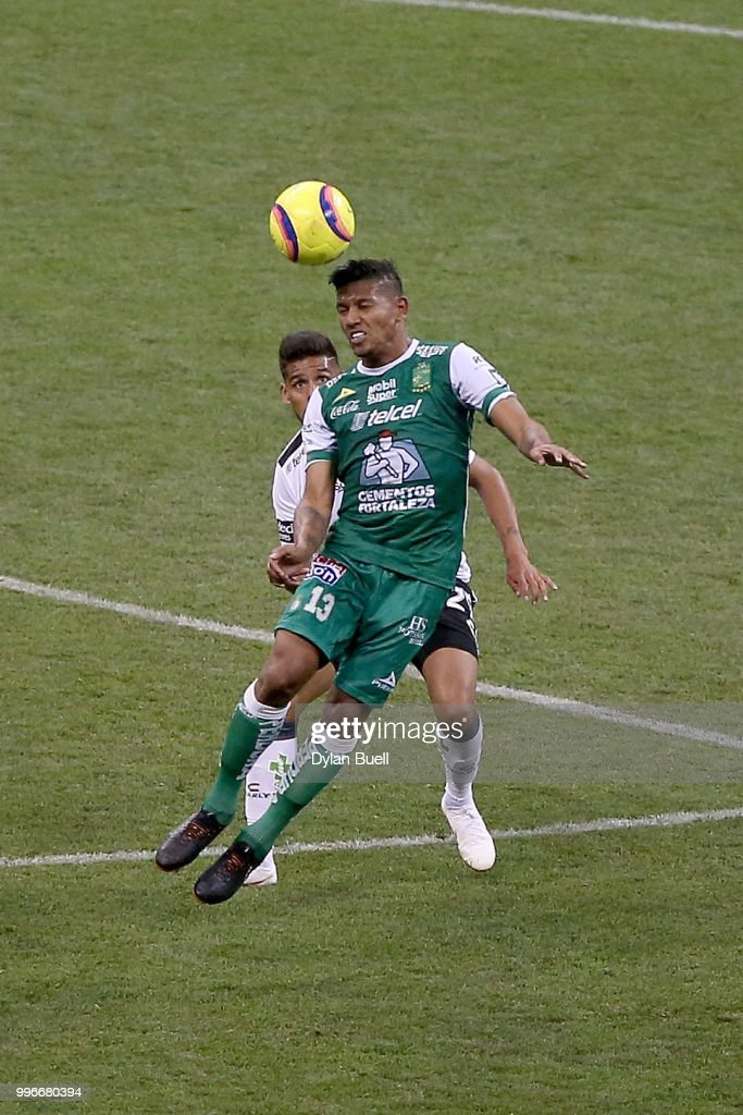 Alexander Mejia #13 of Club Leon heads the ball while being defended by Franco Jara #29 of CF Pachuca in the second half at Miller Park on July 11, 2018 in Milwaukee, Wisconsin.
