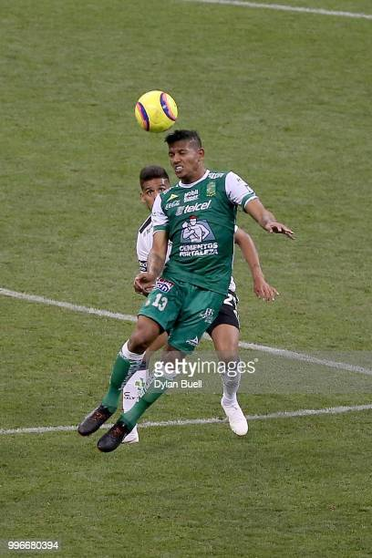 Alexander Mejia of Club Leon heads the ball while being defended by Franco Jara of CF Pachuca in the second half at Miller Park on July 11 2018 in...