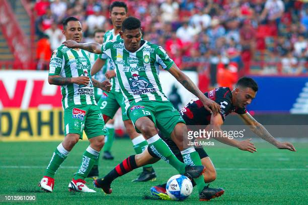 Alexander Mejia of Leon fights for the ball with Luis Chavez of Tijuana during the third round match between Tijuana and Leon as part of the Torneo...