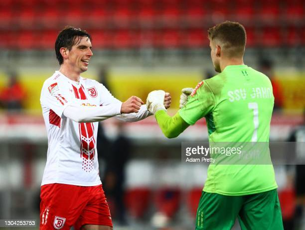 Alexander Meyer of Jahn Regensburg is congratulated by Christopher Moritz of Jahn Regensburg after victory in the Second Bundesliga match between SSV...